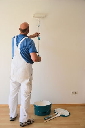 bucket of money: a painter at work
