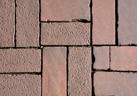 demarcation: Paving stones on a footpath Stock Photo
