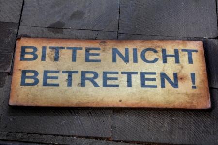 life threatening: Label on a wooden floor