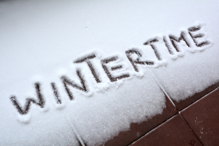 cold weather: Wintertime written on snow Stock Photo