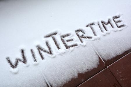 Wintertime written on snow Stock Photo