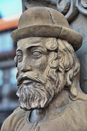 heads old building facade: Wooden head on a historic half-timbered house in Wernigerode Stock Photo