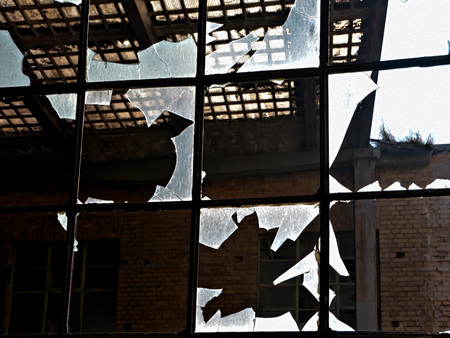 company premises: Destroyed window of a factory Stock Photo