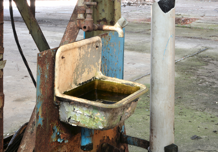 Sink in a disused factory photo