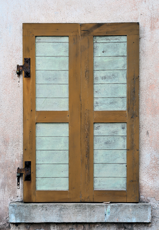 Window shutter on an old house Stock Photo