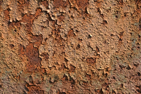 corroding: Rust on the surface of metals, with paint residues