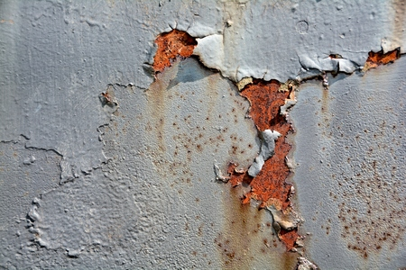 the ageing process: Rust on the surface of metals, with paint residues