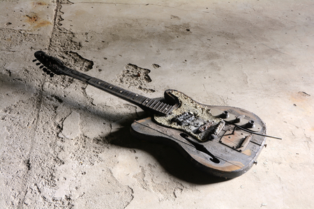 a burned Gittare on the floor of a demolished house in Magdeburg photo