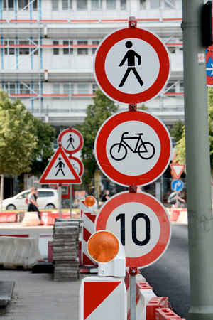 cordoned: Confusion by many traffic signs on a building site in a street in Berlin Stock Photo