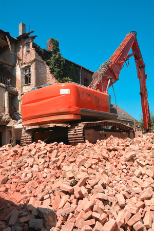 demolished house: excavator on the remains of a demolished house in the old town of Magdeburg