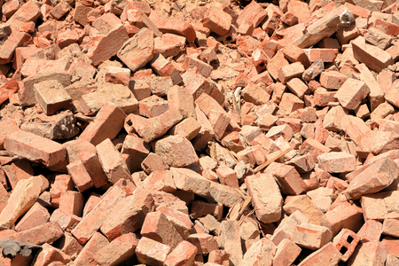 pile of rubble of bricks after the demolition of a house Stock Photo
