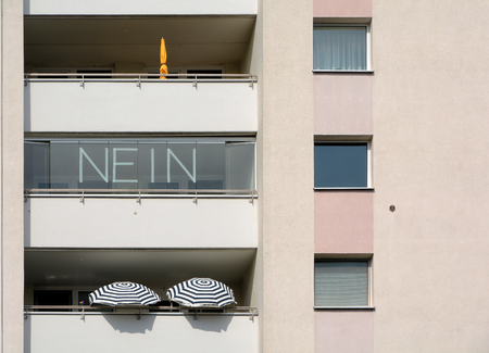 property berlin: Lettering with the word  No  on the balcony of a house in Berlin