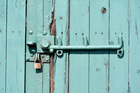 padlock shut off: green garage door Stock Photo