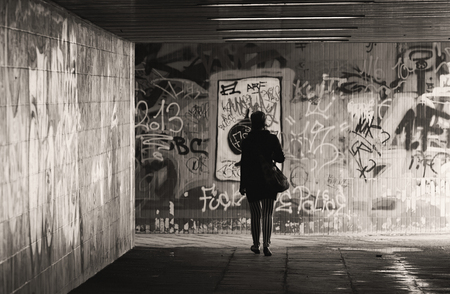 Magdeburg, GERMANY - August 15, 2014 a woman goes through to underpass to get to the other side of a busy road