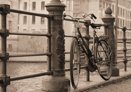 Bicycle on a promenade on the river Spree in Berlin photo