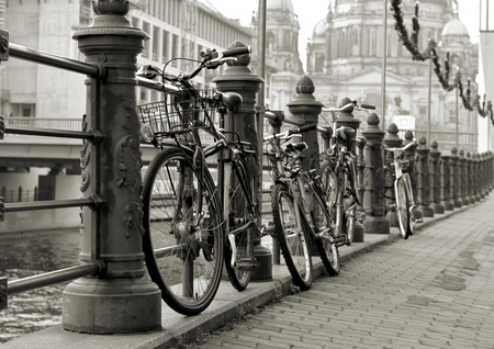 Bicycles on a promenade on the river Spree in Berlin photo
