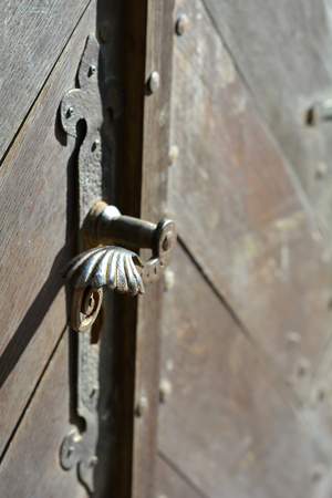 historic door handle on an old door in Quedlinburg photo