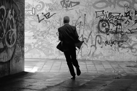 daubed: MAGDEBURG, GERMANY - August 15, 2014: A man runs through an underpass in Magdeburg