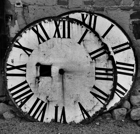 clock faces of an old clock tower photo