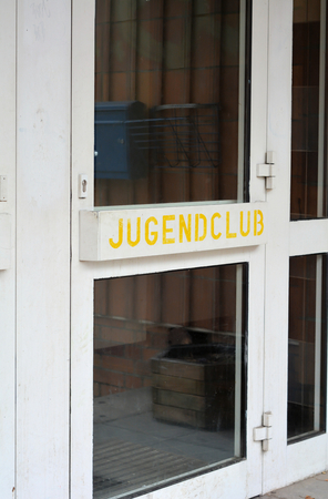 pedagogy: entrance door to a youth club in Berlin