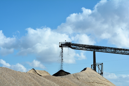 conveyors: quarrying of sand and gravel in a gravel pit Stock Photo