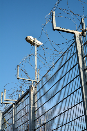 Video surveillance and barbed wire fence on private land photo