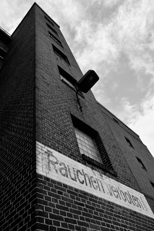 industrial wasteland: abandoned factory building the inscription on the facade no smoking