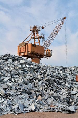 Crane and scrap metal in a junkyard in the port of Magdeburg