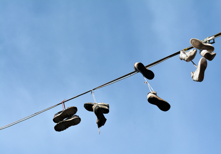 disposed: disposed of shoes hanging on a leash