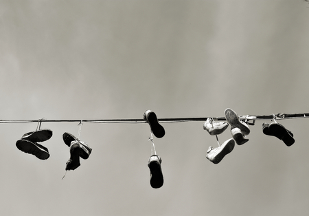 disposed of shoes hanging on a leash