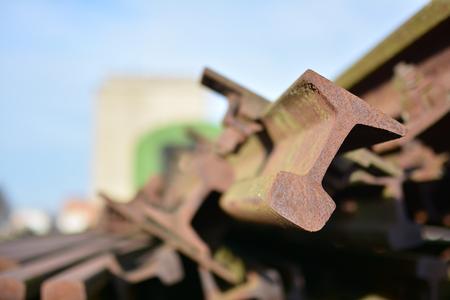 salvage yard: rusted railroad tracks