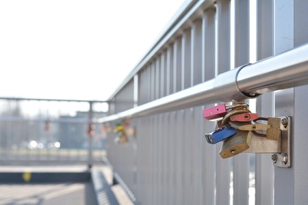MAGDEBURG, GERMANY - MARCH 18, 2015: Padlocks as proof of love on a bridge in Magdeburg Editorial