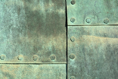 verdigris: close up of weathered copper sheet at a historic old door at the Cathedral of Magdeburg