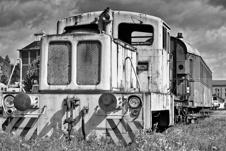 scrapped: old disused locomotive on the siding at the port of Magdeburg Stock Photo