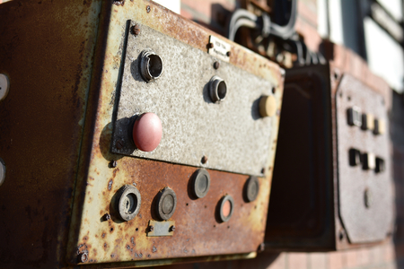 industrial wasteland: Buttons on a control panel of a machine to a building in the harbor of Magdeburg