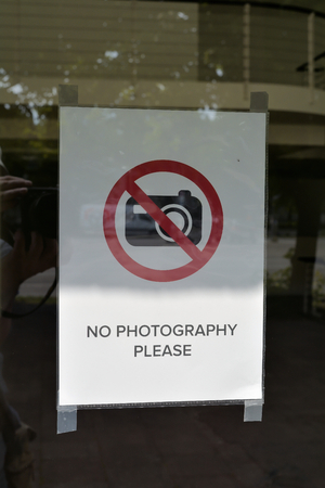 banning the symbol: photo ban at the entrance door to a shop in Berlin