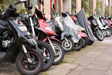 road side: Berlin Germany 18 May 2015: scooters on the road side in Berlin