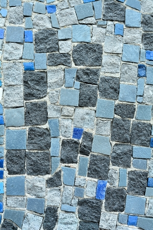 coverings: mosaic stones on a facade in Berlin Stock Photo