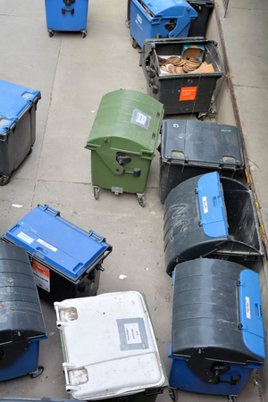 throwaway: BERLIN GERMANY MAY 18 2015: dumpsters on a backyard in the city center of Berlin Editorial