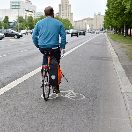 one lane road sign: Cyclists in the city center of Berlin Stock Photo