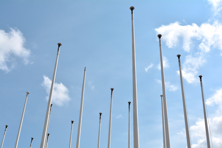 blue sky and flagpoles in Berlin Stock Photo