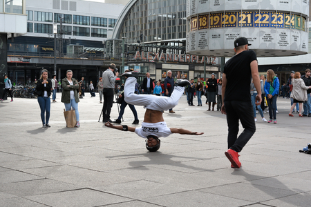 breakdancing: BERLIN, GERMANY - MAY 20, 2015: breakdancer on the Alexanderplatz in Berlin city center