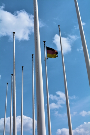 flagpoles: flagpoles with Germany flag in Berlin Stock Photo