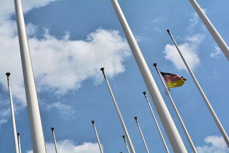 flagpoles with Germany flag in Berlin Stock Photo