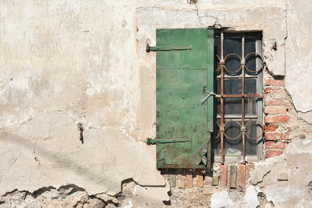 window shutter on an old house in the city of Lesce in Slovenia