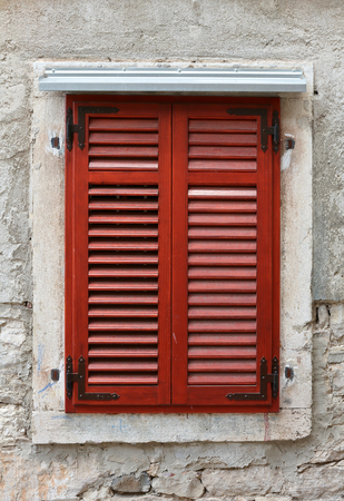 window shutter on an old house in the old town of Pula in Croatia