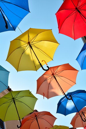 protection concept: Umbrellas as decoration on a shopping street Stock Photo