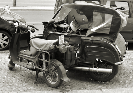 injuring: BERLIN, GERMANY - MAY 20, 2015: Simson Scooter and Krause duo from GDR production roadside in Berlin