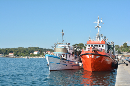 fishing fleet: Rovinj, Croatia - July 14, 2015: Fishing boats in the port of Rovinj in Croatia