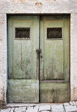 old buildings: Old wooden door in the old town of Rovinj in Croatia